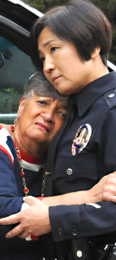 Image of female officer embracing/comforting a woman
