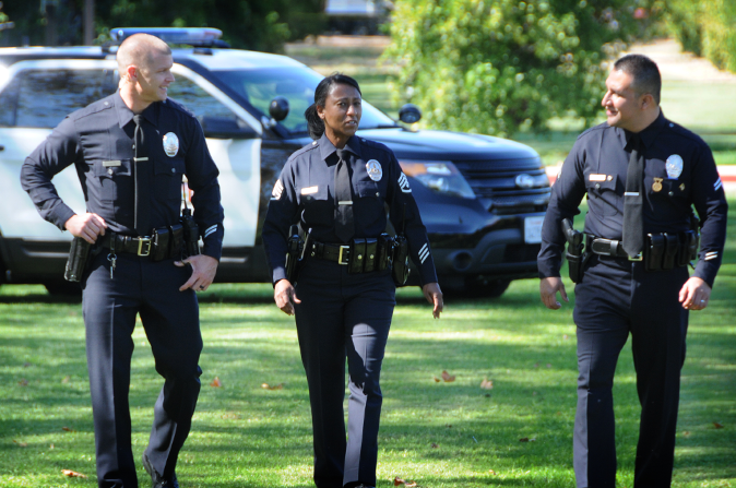 3 officers walking in the park discussing benefits