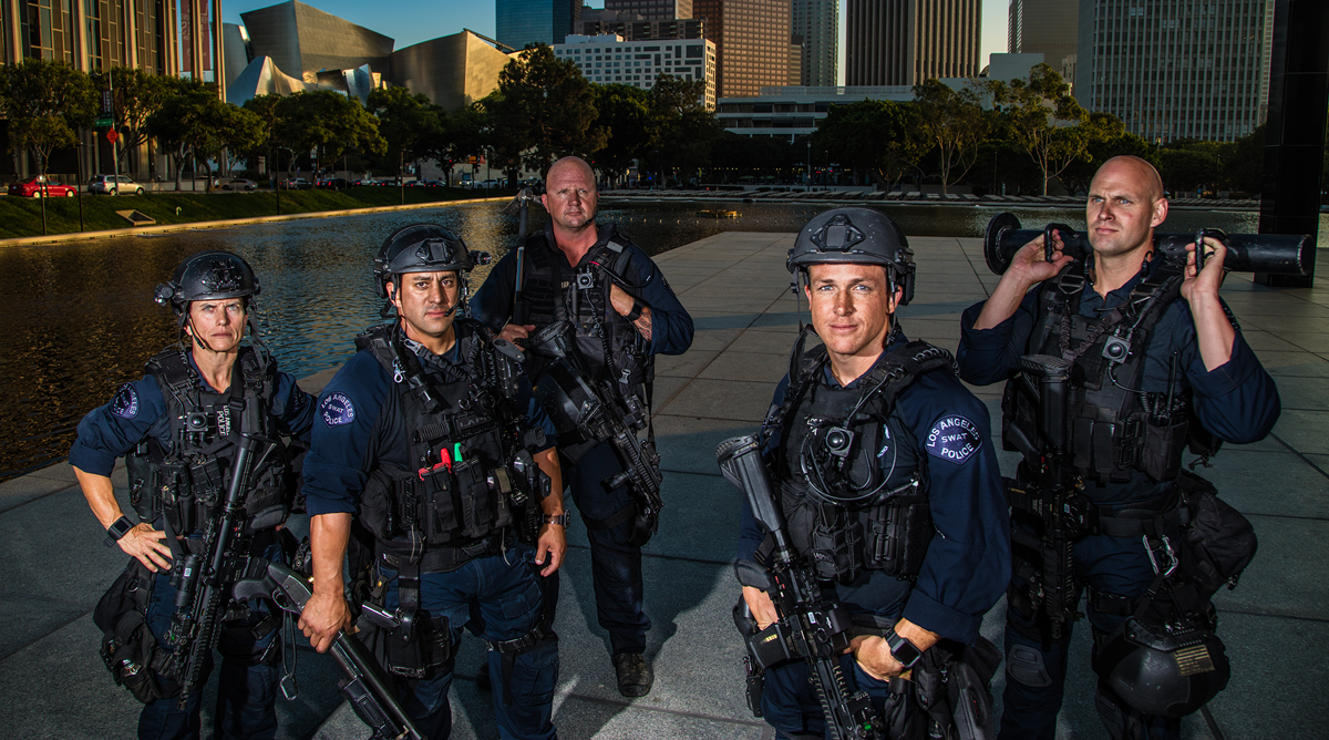 Metro officers group with buildings as background